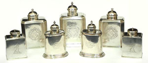 A formidable array of early 18th-century English sterling silver tea caddies. Stephenson's Auctioneers image.