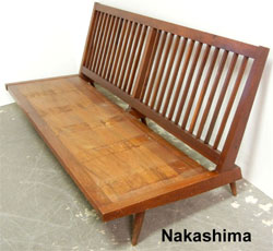 Nakashima 1954 walnut sofa from a living room suite to be auctioned in three lots. Stephenson's Auctioneers image.