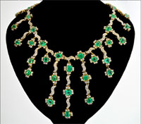 18K yellow and white gold necklace with 35 emeralds weighing 19.02 carats and 288 diamonds weighing 7.20 carats. Estimate $43,000-$86,000. Government Auction image.