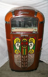 1940s Rock-Ola jukebox with illuminating Art Deco façade, est. $5,100-$10,200. Government Auction image.