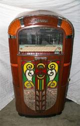 1940s Rock-Ola jukebox with illuminating Art Deco façade, est. $5,100-$10,200. Government Auction image.