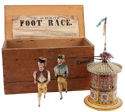 The Automatic Foot Race, 1880s, William Britain & Sons (England), featuring two cloth-dressed figures that trot around a paper-litho metal cylinder, $18,400. Noel Barrett Auctions image.