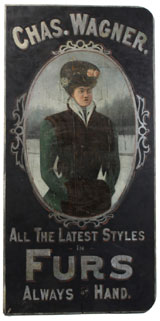 19th-century, full-color wood sign advertising Chas. F. Wagner Furs, $26,450. Noel Barrett Auctions image.