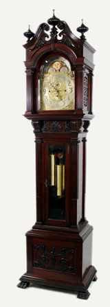 Late-19th-century Tiffany & Co. carved mahogany grandfather clock, 100 in. tall, with Winterhalder & Hofmeier German movement, sun/moon dial, eight bells, Westminster chimes. Est. $3,000-$5,000. Nest Egg Auctions photo