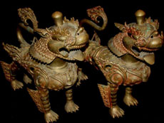 Pair of large, bronze foo dogs, Estate of Dr. Caldwell Titcomb. Tonya A. Cameron Auctioneers image.