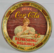 1900 Coca-Cola serving tray featuring the soft drink company's first model, Hilda Clark; 9½ in. diameter. Est. $2,000-$3,500. Morphy Auctions image.