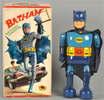 1966 battery-operated walking Batman toy, tin with vinyl head and original cloth cape, original box. Est. $4,000-$8,000. Morphy Auctions image.