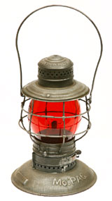 This MoPac (Missouri Pacific) railroad lantern with ruby-colored glass is one of approximately 160 lanterns from various train lines in the Roy Gay collection. A&S image.