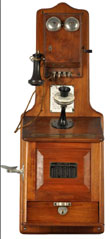 From the Bill Daniels collection – Part II, circa-1904 silver dollar pay station telephone manufactured by the Gray Co., walnut with Western Electric 'pony' receiver, est. $5,000-$7,000. Morphy Auctions image.