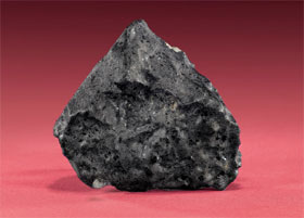Tissint Martian meteorite that fell to earth July 18, 2011; believed to have solidified from lava 400-500 million years ago, extraordinarily rare, est. $200,000-$300,000. I.M. Chait image.