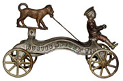 Cast-iron Buster Brown and Tige pull toy by Watrous (American). Mosby & Co. image.