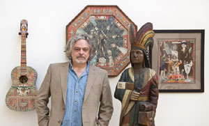 Material Culture's founder/owner George Jevremovic with a few of his May 5 debut auction's predicted top lots, including a 19th-century Samuel Robb cigar store figure, est. $40,000-$60,000. Material Culture image.