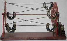 Circa-1895 Hubley Toy Co. Gondola Amusement Park Ride, clockwork cast iron, brass and wood. Est. $30,000-$40,000. RSL Auction Co.