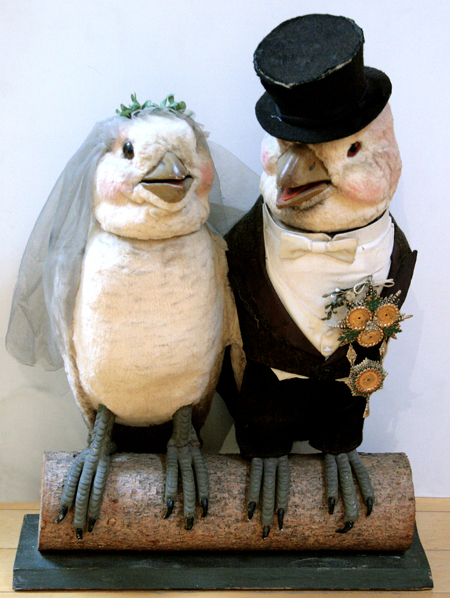 Animated, electric-powered store window display of birds in bridal attire. Ross Art Group image.