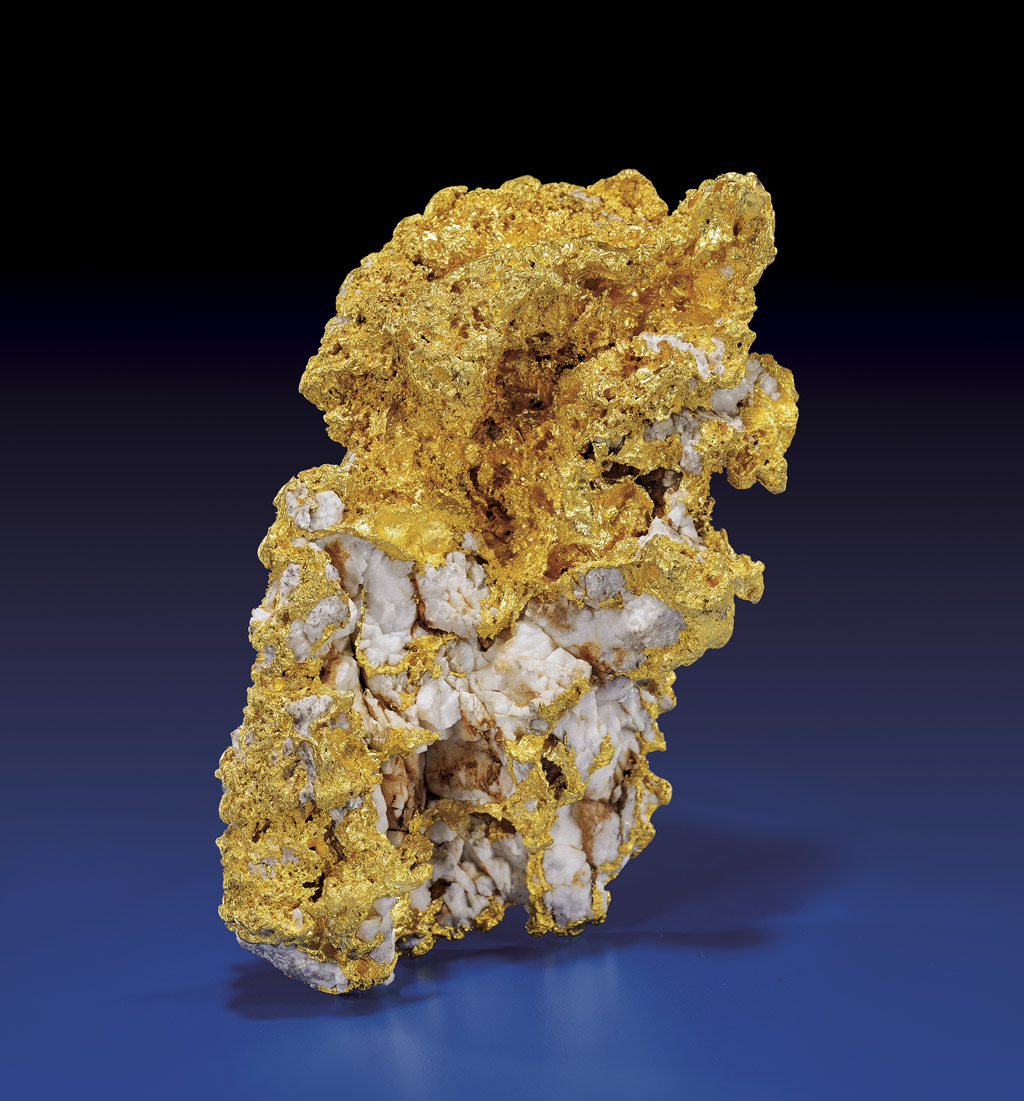 Gold nugget with natural quartz containing 3100g (99.67 ozt) of gold, origin central Victoria, Australia. Estimate $275,000-325,000. I.M. Chait image.