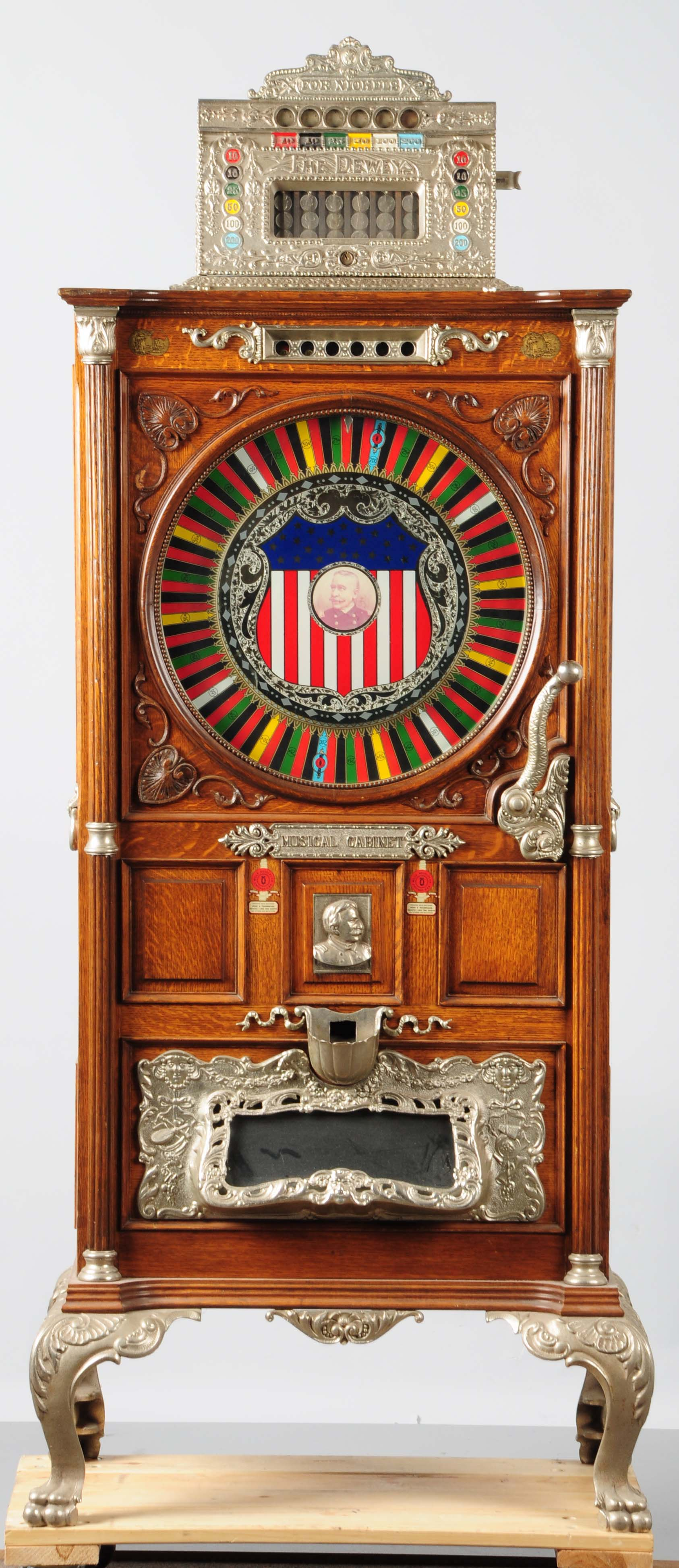 Mills 5-cent Dewey musical upright slot machine, working order with excellent repertoire of tunes. Est. $15,000-$18,000. Morphy Auctions image.