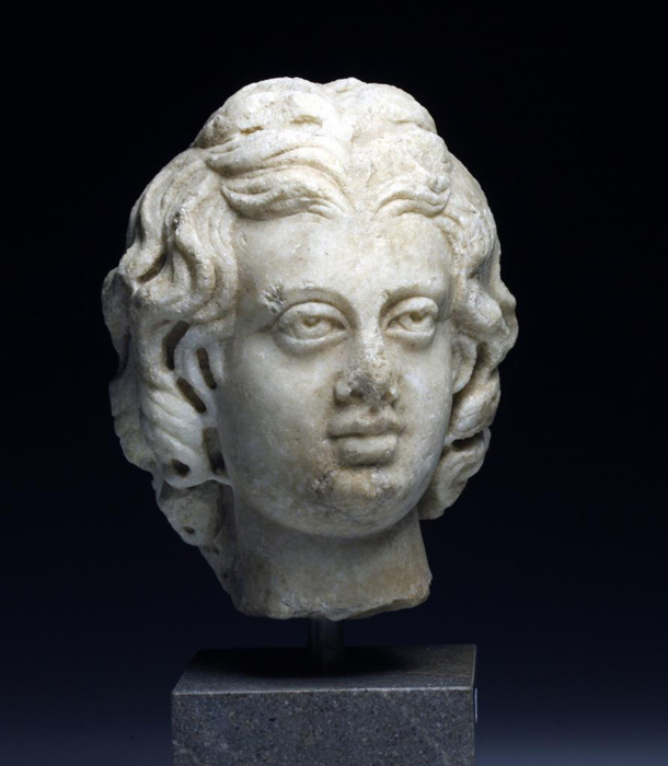 Roman Marble head of Eros, Antonine Period, est. $15,000-$20,000. Antiquities Saleroom image.
