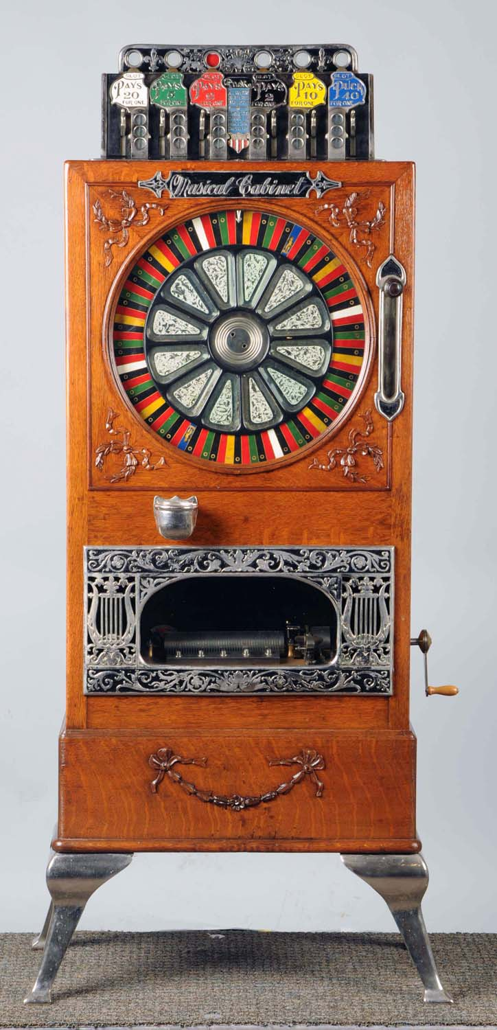 Caille Puck 5-cent upright slot machine with music, pre-1900, stocked with great American tunes, plays well. Estimate: $18,000-$22,000. Morphy Auctions image.